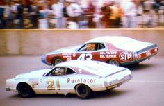 David Pearson's #21 Purolator Mercury and Richard Petty's #43 STP Dodge.
