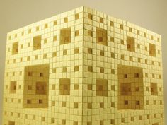 """A mini Menger sponge built from Post-Its.  Each Post-it was torn into 16 equal squares, then folded into units and assembled into the sponge.  Post-Its offer surprisingly structural durability and are easy to get in large quantities making them ideal for assembling structures like these.  Started: June 21, 2009 Finished: November 5, 2011 (867 days later)  Dimensions: 11.125"""" x 11.125"""" x 11.125"""" Pos-its: 4,128 (66,048 units)  Inspired by Dr Jeannine Mosely's original sculpture ..."""
