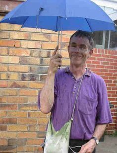 On 7 January 2003 I did something that I have wanted to do for years. It was a hot day.  I purchased an umbrella, a battery powered water pump and some plastic tubing. I then set it up with a battery, a 5 litre container of water and a push button switch.  With the water bottle, battery and pump in a small backpack I walked along some crowded city streets with my own rain falling from under my umbrella.  I had lots of fun and enjoyed the comments from so many people