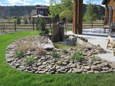 River rock flower bed--this is what I will do with all the rocks in my yard!