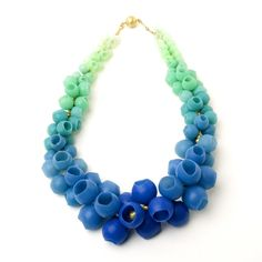 Jenny Llewellyn: Plume Necklace , silicone and 18ct gold plated silver