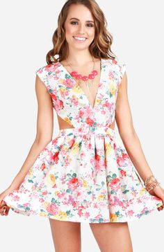 Floral Print Cut Out Dress  $59.99  Style #: 69237  Cap sleeve floral mini dress with cut out at sides and low v-neck. Invisible zipper in back. Tulle lining.  Select Color: White