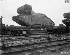 Battle Cambrai 20 - 30 November 1917 (Q 46933)   British Mark IV Female Tanks being loaded aboard flat-bed railway trucks at Plateau Station in preparation for transportation to the forward area prior to the opening of the Battle of Cambrai.