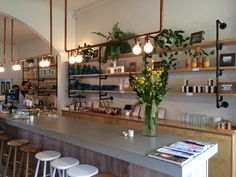 A new cafe in our area, I love the pipe work shelves and lighting.