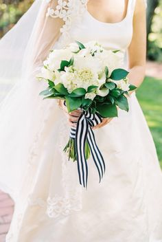 Ivory flowers with greenery and striped ribbon: http://www.stylemepretty.com/2015/03/26/romantic-nautical-cape-cod-wedding/ | Photography: Trent Bailey - http://www.trentbailey.com/