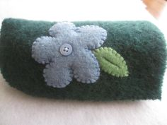 Glasses Case Felted Wool Eyeglass Case Green with Blue Flower, Upcycled Felted Wool. $8.50, via Etsy.