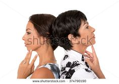 Portrait of happy mother and young daughter in profile  on white background.Family relationship, love, affection. - stock photo