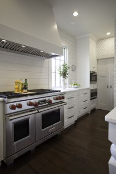 plywood planks as backsplash. This kitchen is sheer perfection! Photobucket