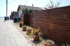Turning wood slats sideways, turned my fence concepts on their heads! What a great idea for a modern look.