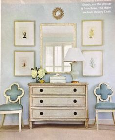 Console table, chest art grouping and arrangement for hallway. Soft colors white and aqua