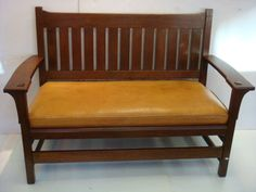 """L and JG STICKLEY Arts & Crafts Drop Arm Settee, #225: Classic Form with Scooped Back Rail and Through Tenon Construction, Quartersawn Oak and in Pinned all Around Drop-Retains Original Drop in Spring Set with Newer Leather Seat. 36""""T X 52""""W X 25""""D. Back Stretcher Still Bears Paper Label and was Featured on Page 10 in 1912 Catalog. Shows a few Minor Cigarette Burns and Scratches. ORIGINAL FINISH. 36.25""""X 52.5"""" X 25.25, Arm Height 25"""", Seat Height 16"""". Arts & Crafts Gem. (2500-4000)"""