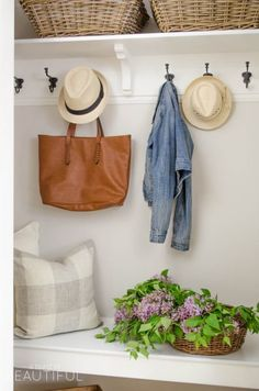 Love this small mudroom with bench, shelf and lots of hooks