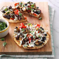 Grilled Eggplant Pita Pizzas Recipe -We grow eggplant and love to use it for our special pizza. Grilling adds robust flavor to the crust, veggies and garlic. Waiting for the eggplant to grow is the hardest part! —Judy Barrett, Chelsea, Alabama