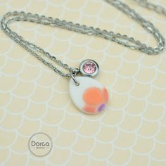 Tiny charm necklace . Porcelain, zirconia, surgical steel.