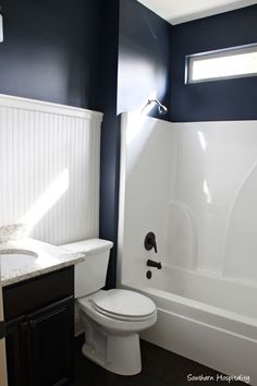 white beadboard and navy walls,  Naval by Sherwin Williams.