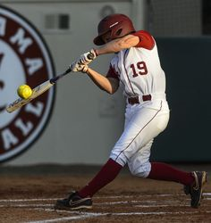 Alabama Infielder Danielle Richard (19) smashes a two-run home run