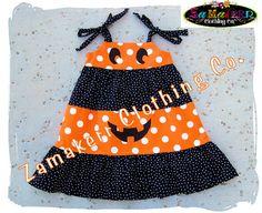 Custom Boutique Clothing Halloween Orange N' Black Dots Tiered Pumpkin Face Twirl Dress 3 6 9 12 18 24 month size 2T 2 3T 3 4T 4 5T 5 6 7 8. $39.99 USD, via Etsy.