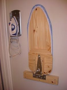 A Little Tipsy: DIY Wall Mounted Ironing Board  (make to fold down over washer in laundry closet)