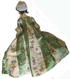 18th century doll wearing a sack back gown. The clothes are all original and in remarkable condition.  Unfortunately there is no full picture of the front of the gown.