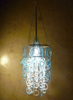 aqua chandelier made from recycled glass bottles                                                                                                                                                                                 More