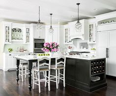 Marriage of Styles. Love the Kitchen Island with seating.