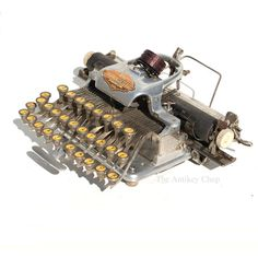 This little gem is often affectionately referred to as The Five Pound Secretary. See the Blick typewriter here… Antique Typewriter, Neon Clock, Vintage Phones, Portable Typewriter, Cash Register, Vintage Typewriters, Writing Instruments, Fountain Pen, Etsy Store
