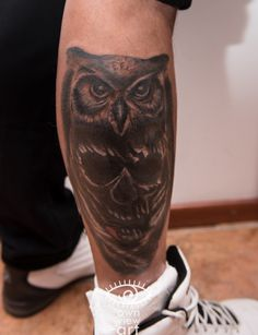 huge coverup owl skull tattoo