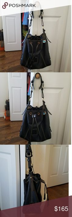 Dooney & Bourke Drawstring Handbag Gorgeous Dooney & Bourke drawstring handbag. Adjustable straps. No scuffs or scratches on the outside or inside. I side is clean. Very gently used. Everything is intact. I love this versatile bag but need to downshize. Dooney & Bourke Bags Shoulder Bags