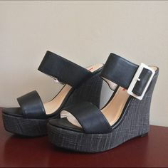 "🎀NIB Black/Gray Buckle Wedged Sandals🎀 🎀NEW IN BOX Black/Gray Buckle Wedged Sandals🎀 Black Straps with a White Metal Buckle atop a Woven Smoky Gray Fabric. Lightly cushioned footbed for comfort. Wedge Height-5"" Platform Height-1 1/2"" Wedge Width-1 1/4"" Footbed Width-2 3/4"" Insole Width-1 1/4"" Length from back of heel to toe-8 1/4"" C Label Shoes Sandals"