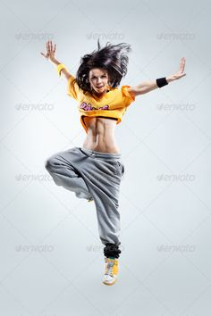 the dancer ... <p>young beautiful modern style dancer posing on a studio background</p> Agility, acrobat, action, active, adult, aerobics, balance, breakdance, breakdancer, color, cool, cute, dance, dancer, dancing, exercise, exercising, female, fitness, flexibility, fly, funky, girl, gymnastic, hip-hop, human, joy, jump, mid-air, modern, moving, one, performance, performer, pose, posing, smile, stretching, studio, style, up, vertical, woman, young