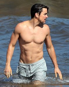 Impressive: The 37-year-old actor was seen showing off his rippling six-pack as he emerged from the sea