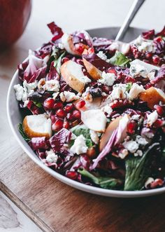 Easy, healthy, and festive radicchio, pear, gorgonzola, pomegranate, and walnut salad. Perfect to serve to a crowd over the holidays!
