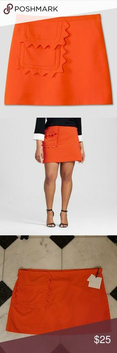 Skirt, 3X, Victoria Beckham for Target, NWT Orange skirt with scalloped flap pocket. Pics one and two show fit, rest are my skirt. Side zipper, hook and eye. Size 3X. Waist approximately 26 inches across flat with stretch. Approximately 19 inches long. According to size chart, 3X is 24W to 26W, bust 51 to 53 inches, waist 46.75 to 48 inches (hard to read), hips 53 to 56 inches. Fabric pic 7. New with cut tags. Victoria Beckham for Target Skirts