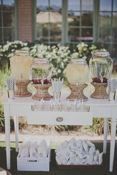 like the idea of different drinks and flavored water with striped straws for heat before ceremony starts
