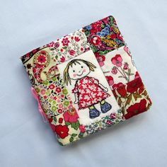 Rich bright colours in fabrics that exude good cheer like this Liberty Tana Lawn patchwork needle case with its sweet applique and machine embroidered doll on the front Freehand Machine Embroidery, Free Motion Embroidery, Learn Embroidery, Machine Embroidery Patterns, Vintage Embroidery, Embroidery Applique, Liberty Quilt, Liberty Fabric, Sewing Crafts