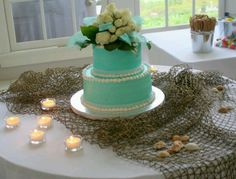 Aqua Wedding Cake with white flowers - add some peach or coral