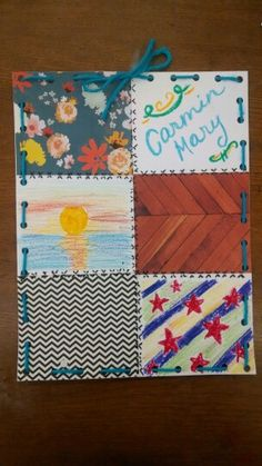 "Quilts. We used scraps of patterned paper, oil pastels, and colored pencils for the rectangles. ""Stitches were made by drawing 'x's. And, finally, the trim was made using various colors of yarn"