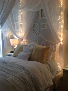 Gray walls using Behr gentle rain... Canopy and white bedding. My teen loves her new room.