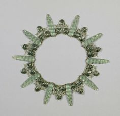Grape Necklace - Stylized elongated clusters of grapes alternate with leaf and vine formations in gold with green cloisonne enamel.  The ten grape clusters are of molded, translucent glass and are attached by prongs to green enameled grounds  -  Rene Lalique   c.1903