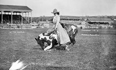 Miss Lucille Mulhall at the Calgary Exhibition and Stampede, 1912.  So, how many cowBOYS could have managed to do their tricks while handicapped by those clothes?