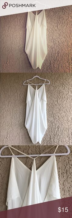 glamorous white dress 100% polyester white dress. Picture doesn't give dress justice on its glam! The front is a deep v cut and the back is a low cut. Beautiful and feminine dress!!! Poetry Dresses High Low