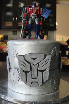 Optimus Prime Transformers cake for my nephew's 4th birthday. Triple chocolate fudge cake filled with ganache on top tier and red velve...