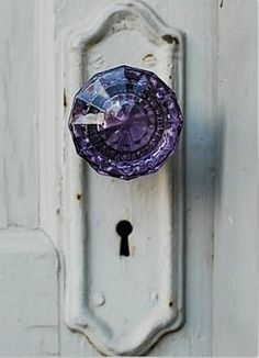 My grandparents had these doorknobs. They are clear when new, and the sunlight turns them violet!  :)
