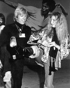 Barbra Streisand is shown a few karate moves by Chuck Norris ~ May 1975