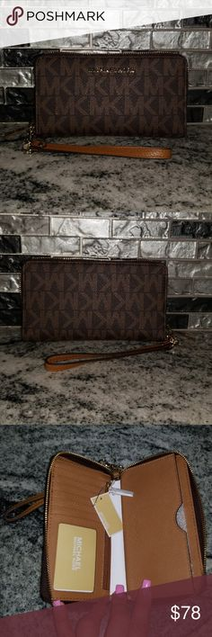 💥 Michael Kors Wristlet 💥 ON HOLD MK Jet Set trav in brown and acorn colors with gold hardware. Strap is detachable.  * 6 card slots * DL/ID window slot * Zip pocket * Additional storage under zip pocket * Phone slot fits my Galaxy S8 with case on BRAND NEW WITH TAGS! Michael Kors Bags Clutches & Wristlets