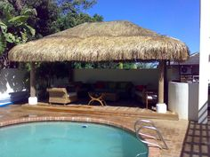 The Alang Alang thatched roof on this pool side cabana gives it an authentic cool feel and keeps the summer heat at bay