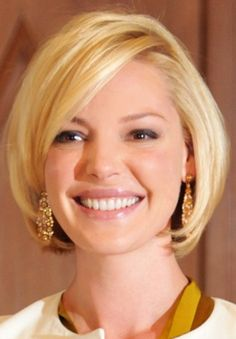 Short Bob Hairstyle for Round Face Shapes - Cute Short Haircuts 2014. Jennifer I was thinking maybe this for you. We could keep it a little longer if you want but I think you could so rock this.