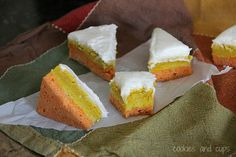 Candy Corn Cookie Bars     1 cup butter, room temperature     2 cups granulated sugar     4 eggs     2 tsp vanilla extract      5 cups flour     1 1/2 tsp salt     1/2 tsp baking soda     orange and yellow food coloring  375°       Bake for 10-12 minutes.     Frosting     1/2 cup butter, room temperature     1/3 cup vegetable shortening     3 cups powdered sugar     2 tbsp milk