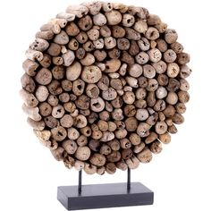 Weathered wood pieces arranged in a circle with a black base. Product: Décor Construction Material: ...