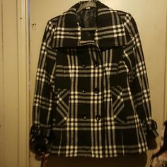 Black and White Striped Pea Coat Black and white striped pea coat with double row of black buttons, and straps with buckles on the cuffs. Excellent condition. Attention Jackets & Coats Pea Coats